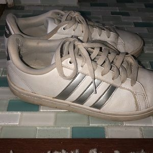 Adidas Superstars with silver stripes